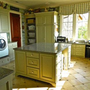 Large traditional u-shaped utility room in Nashville with recessed-panel cabinets, grey cabinets, granite worktops, grey walls, ceramic flooring, a side by side washer and dryer and beige floors.