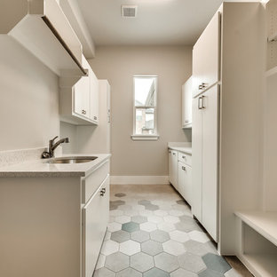 Photo of a large traditional galley separated utility room in Dallas with a submerged sink, flat-panel cabinets, white cabinets, terrazzo worktops, beige walls, ceramic flooring, a side by side washer and dryer, multi-coloured floors and multicoloured worktops.