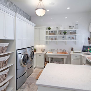 Elegant u-shaped utility room photo in Minneapolis with an utility sink, recessed-panel cabinets, white cabinets and gray walls