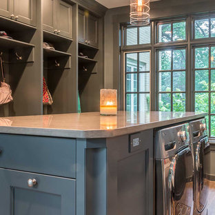 Design ideas for a large scandinavian u-shaped utility room in Chicago with grey cabinets, engineered stone countertops, grey walls, medium hardwood flooring, a side by side washer and dryer and recessed-panel cabinets.