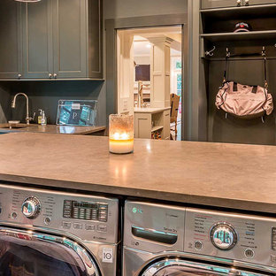 Inspiration for a large scandinavian u-shaped utility room in Chicago with a submerged sink, flat-panel cabinets, grey cabinets, engineered stone countertops, grey walls, medium hardwood flooring and a side by side washer and dryer.