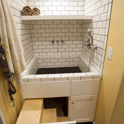 Utility room - large transitional linoleum floor utility room idea in Seattle with an integrated sink, shaker cabinets, white cabinets, laminate countertops, yellow walls and a side-by-side washer/dryer