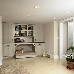 Esempio di una lavanderia multiuso chic di medie dimensioni con lavello sottopiano, ante lisce, top in cemento, pareti beige, pavimento in cemento, lavatrice e asciugatrice affiancate e ante beige