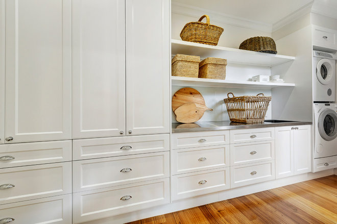Traditional Laundry Room by calm living homes