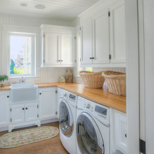 Inspiration for a timeless laundry room remodel in Bridgeport with a farmhouse sink and beige countertops