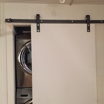 Laundry closet with barn/industrial sliding doors/hinges