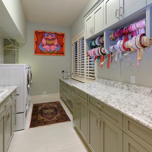 Inspiration for a small coastal galley utility room in Miami with a built-in sink, shaker cabinets, green cabinets, engineered stone countertops, ceramic flooring, a side by side washer and dryer and grey walls.