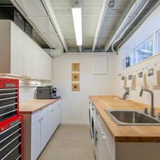 Industrial Laundry Room by Ileana Schinder, PLLC