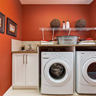 Inspiration for a mid-sized transitional single-wall dedicated laundry room remodel in Calgary with a drop-in sink, shaker cabinets, white cabinets, red walls and a side-by-side washer/dryer