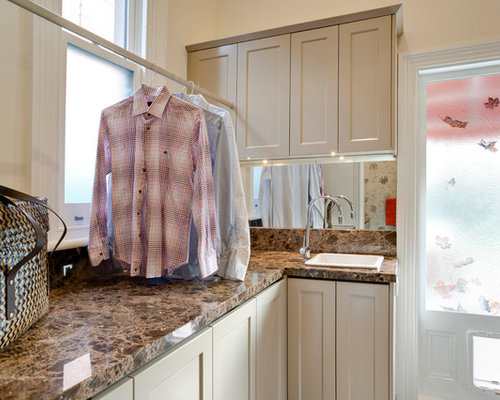 Laundry Room Design Ideas, Remodels & Photos with Brown Cabinets and a Drop-In Sink