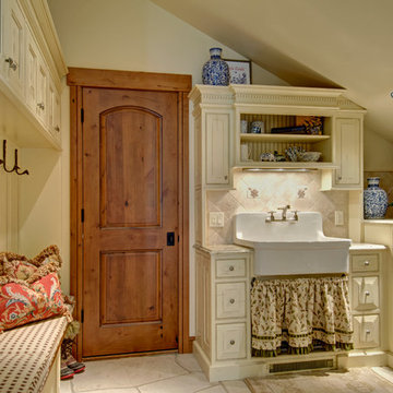 Laundry/Mudroom storage with farm sink