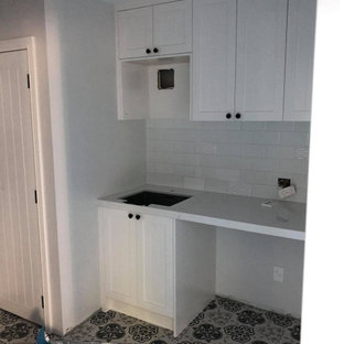 Small victorian single-wall dedicated laundry room in Auckland with an undermount sink, shaker cabinets, white cabinets, marble benchtops, white splashback, subway tile splashback, ceramic floors, an integrated washer and dryer, multi-coloured floor, white benchtop and recessed.