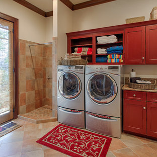 Laundry room - traditional laundry room idea in Other with red cabinets