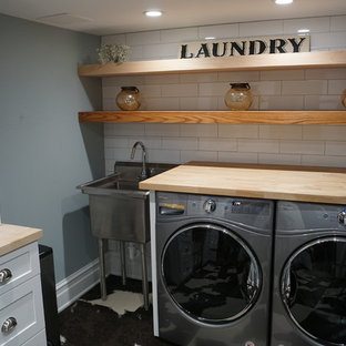 Design ideas for a laundry room in New York with carpet.
