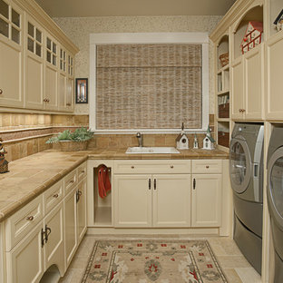 Example of a classic laundry room design in Seattle with tile countertops