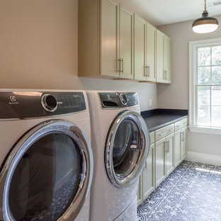 Traditional galley separated utility room in DC Metro with recessed-panel cabinets, beige walls, ceramic flooring, a side by side washer and dryer, multi-coloured floors, black worktops, a submerged sink and beige cabinets.