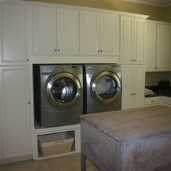 laundry room by Brewer Cabinets