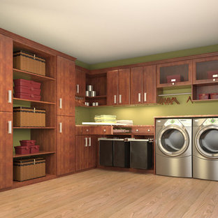 Photo of a mid-sized contemporary l-shaped laundry room in Los Angeles with flat-panel cabinets, medium wood cabinets, green walls, light hardwood floors and a side-by-side washer and dryer.