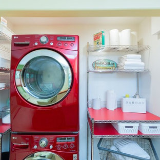 Inspiration for a small mid-century modern laundry closet remodel in Detroit with a stacked washer/dryer