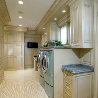 Design ideas for a large traditional u-shaped dedicated laundry room in Orange County with white cabinets, beige floor, raised-panel cabinets, granite benchtops, beige walls, porcelain floors, a side-by-side washer and dryer and blue benchtop.