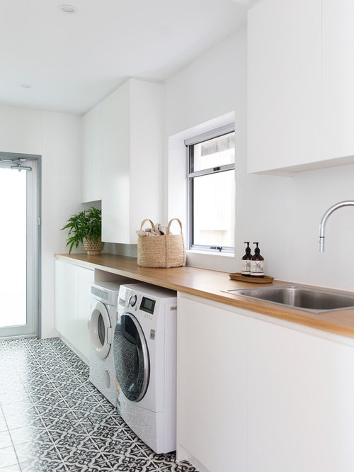 photo of a mid sized contemporary single wall dedicated laundry room in gold coast - Laundry Design Ideas