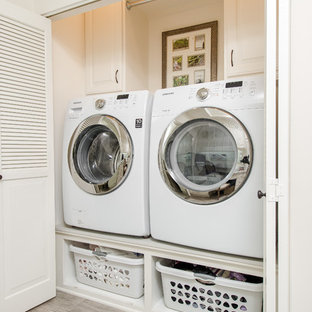 Photo Of A Small Traditional Single Wall Laundry Cupboard In Los Angeles With Raised
