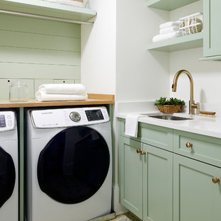 Dedicated laundry room - coastal l-shaped multicolored floor dedicated laundry room idea in Philadelphia with an undermount sink, shaker cabinets, green cabinets, white walls, a side-by-side washer/dryer, white countertops and quartz countertops