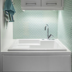 clean and bright modern laundry room white laundry sink glass tiles walls bright modern laundry room