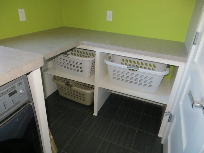 Traditional Laundry Room by L & B Custom Cabinets Inc.