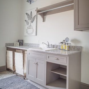 Inspiration for a large farmhouse single-wall utility room remodel in Cleveland