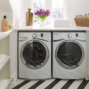 Photo of a contemporary u-shaped laundry room in Minneapolis with open cabinets, white cabinets, white walls, a side-by-side washer and dryer, multi-coloured floor and white benchtop.