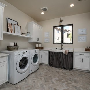 Inspiration for a southwestern u-shaped beige floor dedicated laundry room remodel in Phoenix with an utility sink, shaker cabinets, white cabinets, beige walls, a side-by-side washer/dryer and beige countertops