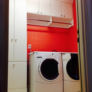 Small contemporary separated utility room in New York with a submerged sink, white cabinets, red walls and a side by side washer and dryer.