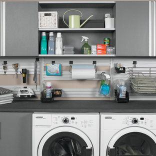 Example of a minimalist laundry room design in Orange County with flat-panel cabinets, gray cabinets and a side-by-side washer/dryer