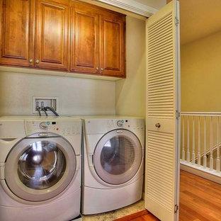 Minimalist laundry room photo in Orange County