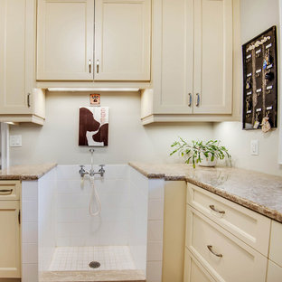 Photo of a large traditional l-shaped utility room in Toronto with a submerged sink, shaker cabinets, white cabinets, granite worktops, white walls, porcelain flooring, a side by side washer and dryer, beige floors and beige worktops.