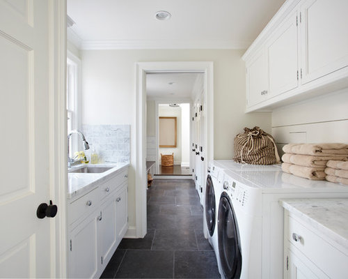 Example Of A Classic Laundry Room Design In New York With White Cabinets Slate Floors