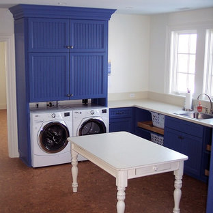 Large country cork floor dedicated laundry room photo in Baltimore with shaker cabinets, blue cabinets and white walls