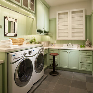 Large traditional l-shaped dedicated laundry room in Salt Lake City with green cabinets, grey floor, a drop-in sink, shaker cabinets, quartz benchtops, white walls, concrete floors and a side-by-side washer and dryer.