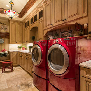 Dedicated laundry room - large mediterranean single-wall travertine floor and brown floor dedicated laundry room idea in Salt Lake City with raised-panel cabinets, medium tone wood cabinets, granite countertops, beige walls and a side-by-side washer/dryer