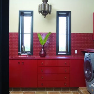 This is an example of an eclectic laundry room in Birmingham with red benchtop.