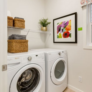 Dedicated laundry room - mid-sized contemporary laminate floor and beige floor dedicated laundry room idea in Calgary with white walls