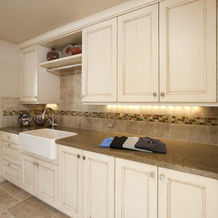 Example of a large cottage galley travertine floor and beige floor utility room design in San Francisco with a farmhouse sink, recessed-panel cabinets, distressed cabinets, beige walls, a side-by-side washer/dryer, concrete countertops and beige countertops