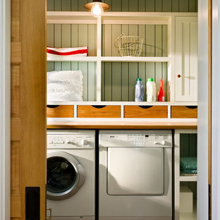 Coastal laundry room photo in Portland Maine with a side-by-side washer/dryer