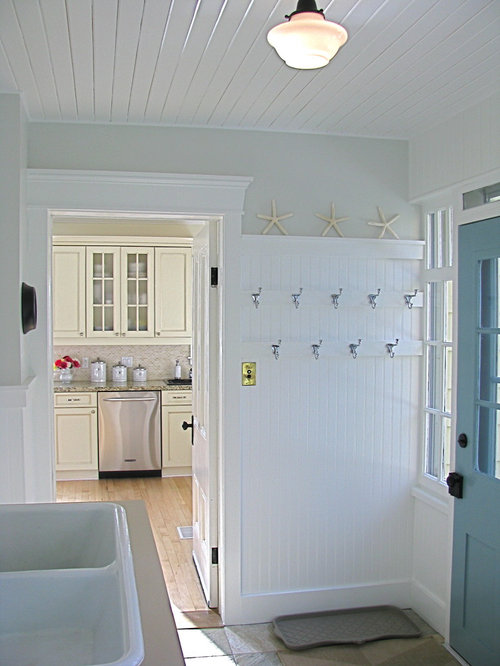 Traditional laundry room idea in Toronto with a drop-in sink
