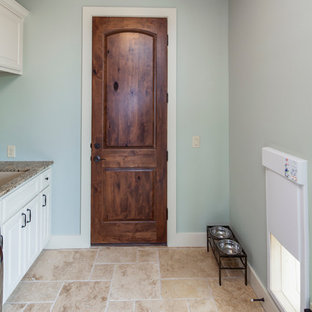 Laundry room with electronic dog door- 2014 Parade Home in Willie Nelson's Tierr