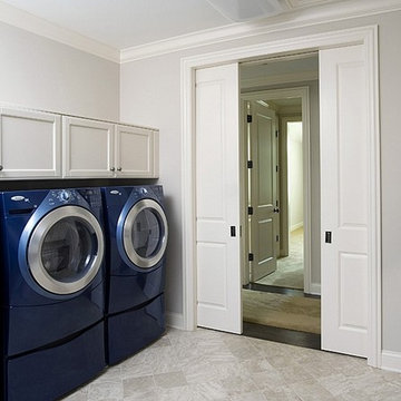 Laundry Room with Two Sets of Washers and Dryers and Flat Panel Cabinetry