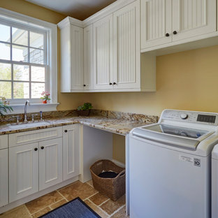 Laundry Room with White Beadboard Cabinetry