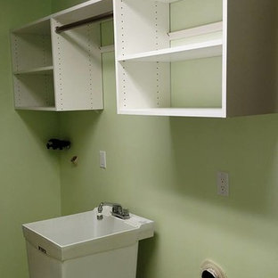 Dedicated laundry room - mid-sized modern single-wall dedicated laundry room idea in Other with an utility sink, flat-panel cabinets, white cabinets, green walls and a side-by-side washer/dryer