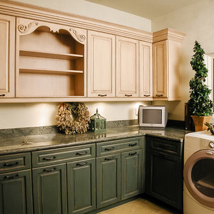Design ideas for a large classic u-shaped utility room in Salt Lake City with raised-panel cabinets, distressed cabinets, granite worktops, white walls, a side by side washer and dryer and green worktops.